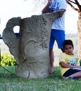 Large pitcher hand built using clay slabs, exposed in the Tuscan countryside as a piece of land art