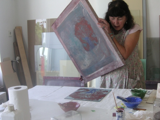 Maria Geszler Garzuly working with the screen of silkprint to transfer image