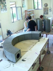 Architectural arch in the stage of compositino, laying out on a table square elements built precisely