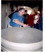 mario Mariani making a huge terracotta pot adding coils while walking backwards