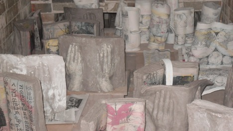Ceramic books with relief print of hands
