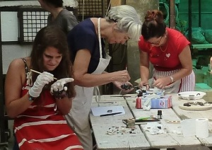 K 12 scool teachers wrking on a project with clay