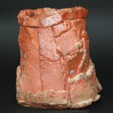 Altered vessel by Jef f Shapiro, woodfired with beautyful orange tone and richely textured surface