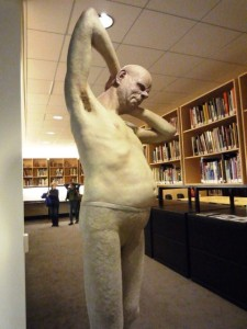 Figurative Ceramic sculpture representing a just woke up man in underware