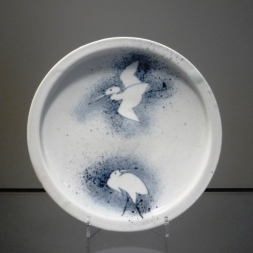 Plate with blown Ink Crane design
