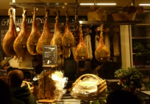Cured hams hanging from the ceiling at the newly rennovated market of san lorenzo in florence