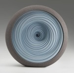 Cramic platter with blue, spiral shaped glaze