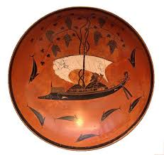 Greek plate with a black decoration showing a sailboad and fishes