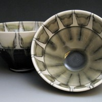 Ceramic bowls with blue centre and line decor