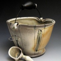 Bucket in ceramics with wire, soda fired.