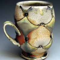 Soda glazed ceramic cup