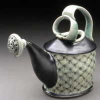 Watering can in ceramics