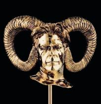 human head with horn in bronze