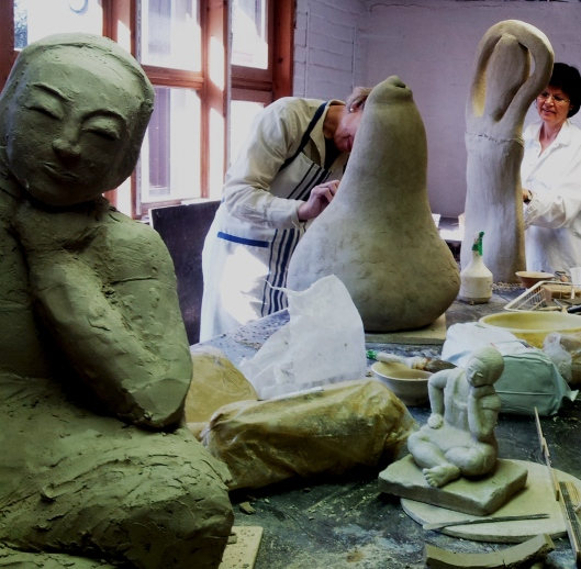 Students building large scale sculptures in clay